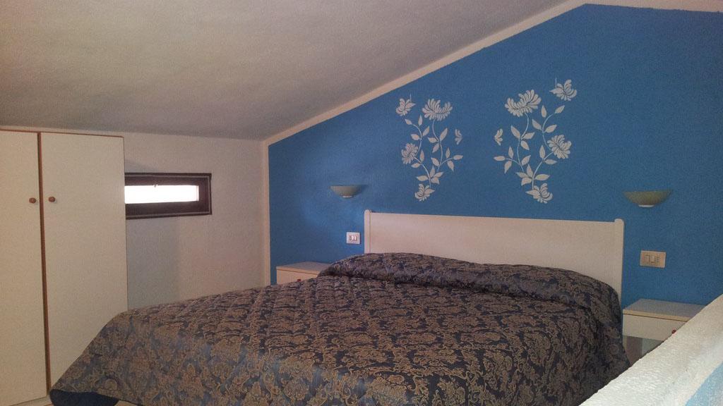 Residence San Teodoro 1 - Camera da letto appartamento monolocale