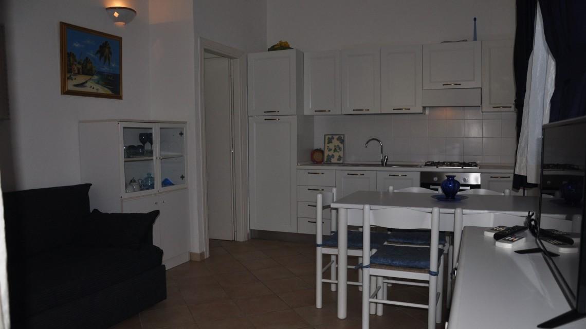 Residence San Teodoro 1. Soggiorno appartamento bilocale